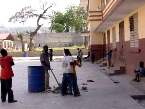 streets in the haitian capital port-au-prince were lined with bodies of the dead, injured and those seeking refuge from crippled buildings in the... - port au prince stock videos & royalty-free footage