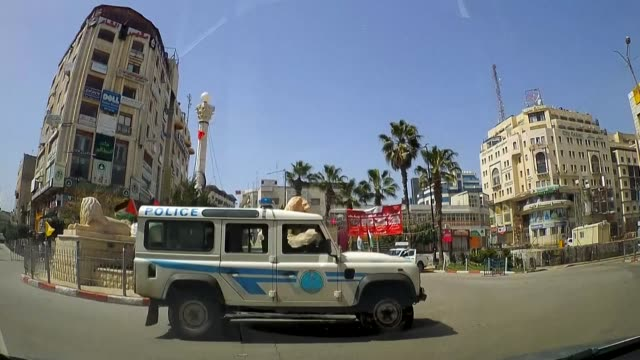 streets lie empty and shops are closed in ramallah in the occupied west bank following a two-week ban on all non-essential movements to curb the... - non urban scene stock-videos und b-roll-filmmaterial