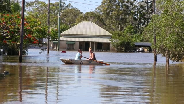 streets of bundaberg underwater as parts of southern queensland experience record flooding in the wake of tropical cyclone oswald on january 30, 2013... - flood stock videos & royalty-free footage