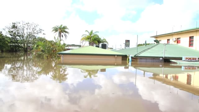 streets of bundaberg underwater as parts of southern queensland experiences record flooding in the wake of tropical cyclone oswald on january 30,... - flood stock videos & royalty-free footage