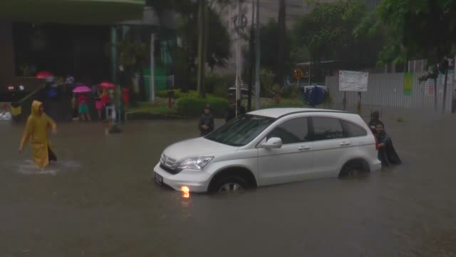 streets of indonesia's capital jakarta have been flooded following two days of torrential monsoon downpours on february 10, 2015. torrential... - monsoon stock videos & royalty-free footage