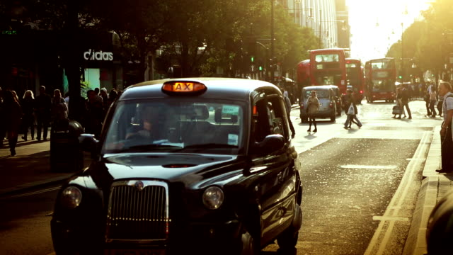 streets of london in rush hours - taxi stock videos & royalty-free footage