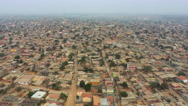 stockvideo's en b-roll-footage met streets of luanda from above. slum and social issues concepts - town