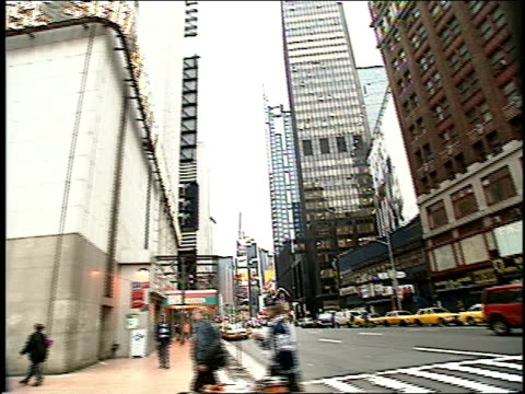 streets of midtown manhattan in new york city in 1994 times square theaters visible - anno 1994 video stock e b–roll