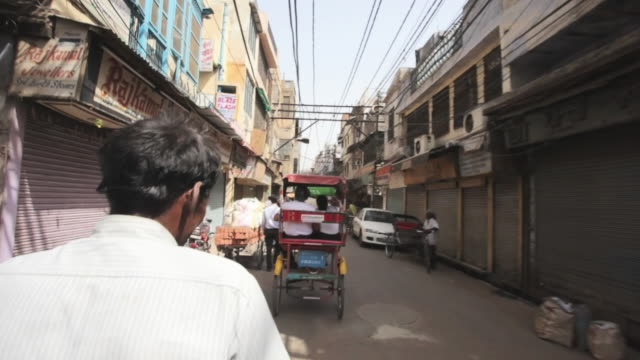 pov streets of old delhi from the back of a bicycle rickshaw / delhi, punjab, india - rickshaw stock videos and b-roll footage