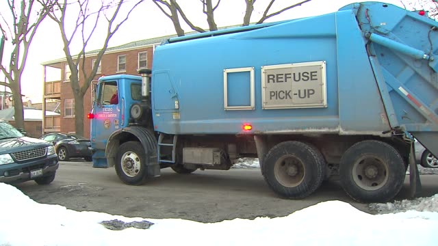 Streets Sanitation Truck Drives Down Streets And Parks in Chicago on Feb 12 2015