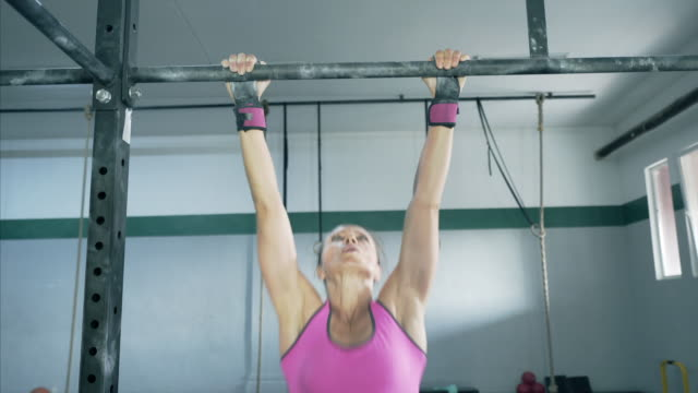 strength is her motto. - chin ups stock videos and b-roll footage