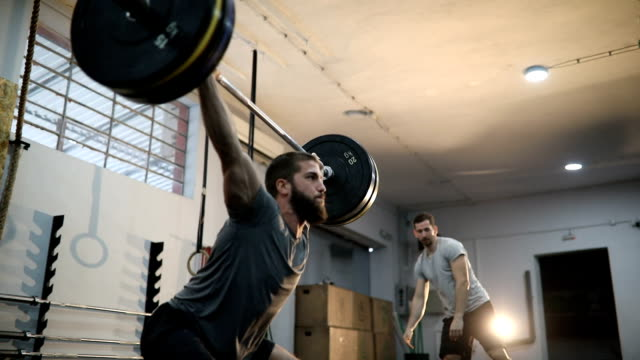 strength is power - weight training stock videos & royalty-free footage
