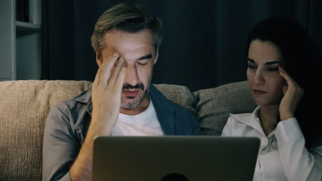 stress man looking at his financial statement with his wife. - poor family stock videos & royalty-free footage
