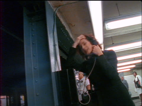 stressed businesswoman talking on pay phone in subway station / nyc - 1998 stock videos & royalty-free footage