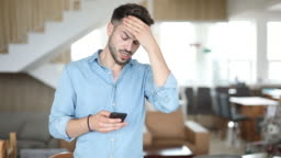 stressed casual salesman standing and texting and then leaves