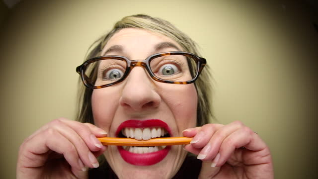 stressed woman biting pencil - pencil stock videos & royalty-free footage