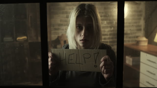stressed women holding help sign - embarrassment stock videos and b-roll footage