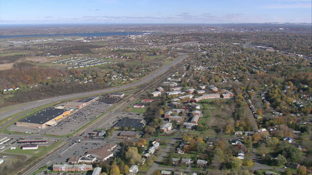 aerial a stretch of highway flanking industrial and residential buildings / syracuse, new york, united states - syracuse stock videos & royalty-free footage