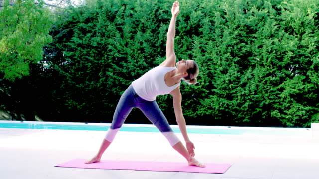 stretch your way into the day - stretching stock videos & royalty-free footage