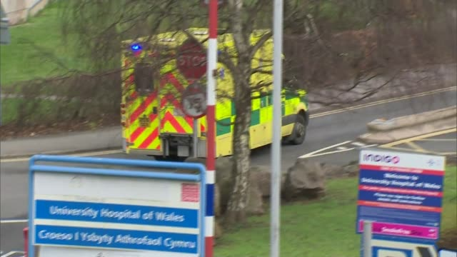 stockvideo's en b-roll-footage met stretched nhs accident and emergency services in wales; wales: cardiff: ext ambulance along road with siren sounding and blue light flashing/... - itv