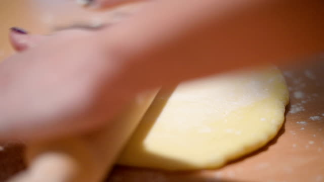 stretching dough - rolling pin stock videos & royalty-free footage