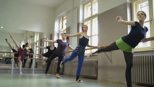 stretching during a barre class - barre stock videos & royalty-free footage