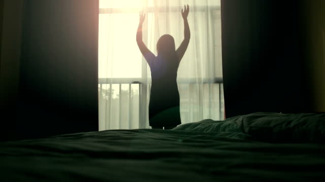 stretching in front of bedroom window - early morning stock videos & royalty-free footage