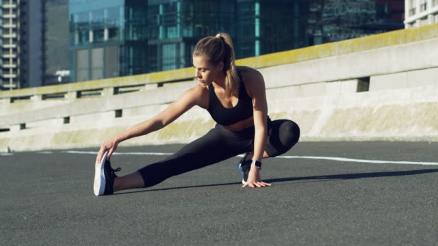 stretching keeps the muscles flexible - stretching stock videos & royalty-free footage