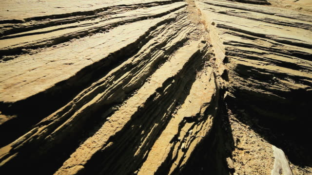 stockvideo's en b-roll-footage met  ms cu pov striations in  rock formations by  natural wind & water erosion  / arizona, united states  - sedimentary rock