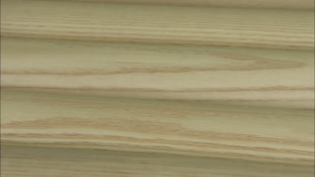 striations mark a piece of wood in a baseball bat factory. - wood grain stock videos & royalty-free footage