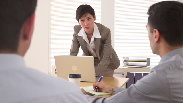 strict businesswoman holding a meeting - puerto rican ethnicity stock videos & royalty-free footage