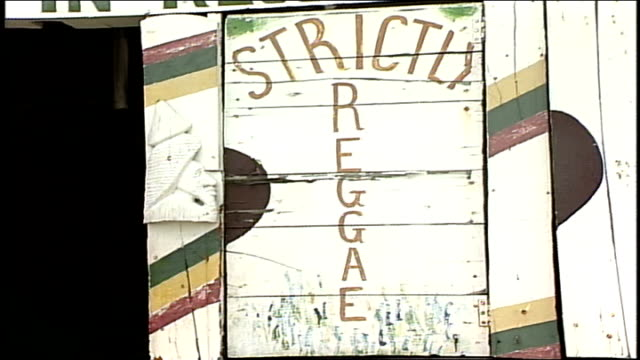 strictly reggae sign on wooden wall - jamaica stock videos & royalty-free footage