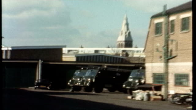 Strike action threatened LIB Green Goddess fire engines parked in yard during 1977 strike ZOOM IN