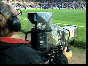 vídeos y material grabado en eventos de stock de strike called off; unspecified location: ext television cameras filming football match - cámara de televisión