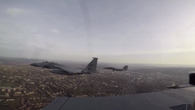 strike eagles fly in formation over sheffield england to mark the 75th anniversary of mi amigo on 22 february 2019 - sheffield stock videos and b-roll footage