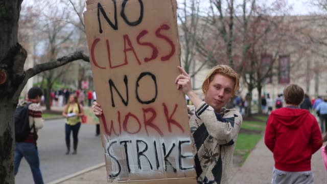 strike protesters march on the campus of indiana university april 11, 2013 in bloomington, indiana. the protesters had a list of issues they were... - loan stock videos & royalty-free footage