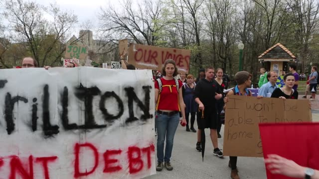 strike protesters march on the campus of indiana university april 11, 2013 in bloomington, indiana. the protesters had a list of issues they were... - 2013 stock videos & royalty-free footage