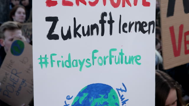 striking high school students march with banners on climate protection and the inscription fridays for future at the starting point to protest for... - climate policy stock videos & royalty-free footage