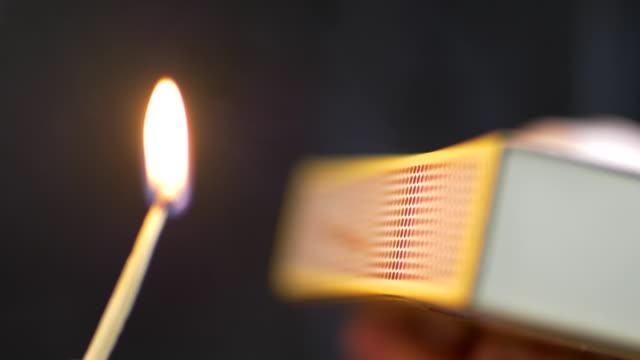 striking & lighting a match, flame burning 2 - streichholz stock-videos und b-roll-filmmaterial