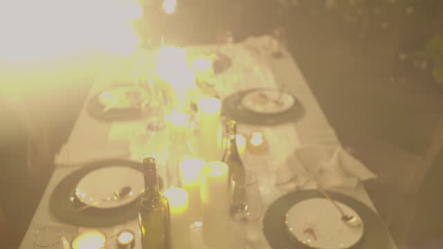 string lights above an empty dinner table - overexposed stock videos & royalty-free footage