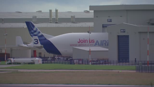string of companies announce major job cuts; wales: broughton: ext gv airbus plane on tarmac at hawarden airport gv airport car park and buildings... - airplane hangar stock videos & royalty-free footage