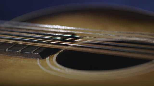 CU Strings and sound hole of stella guitar / England, United Kingdom
