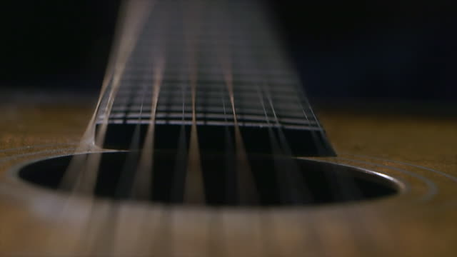 cu strings and sound hole of stella guitar / england, united kingdom - musical instrument string stock videos and b-roll footage