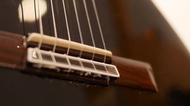 Strings on new guitar at workshop