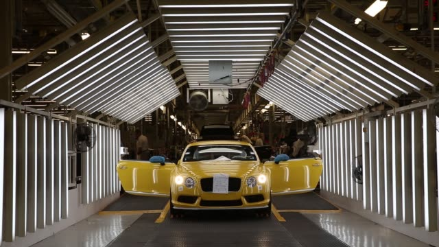 strip lights illuminate a bentley continental automobile as it stands in an inspection chamber during production at the bentley motors ltd workshop... - bodywork stock videos & royalty-free footage