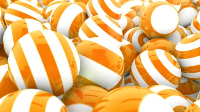 vídeos y material grabado en eventos de stock de stripey orange & blanco esferas - 4 vídeos en 1 - fondo naranja