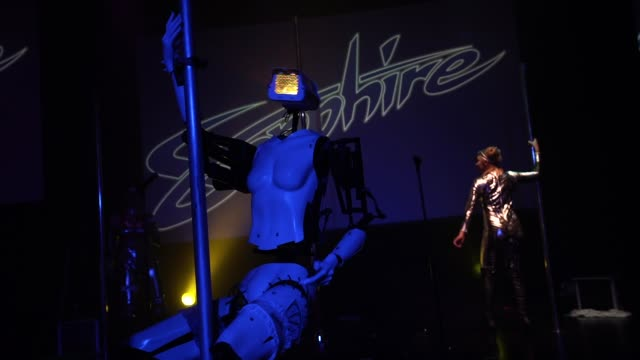 vidéos et rushes de a 'stripper robot' performs alongside with pole dancers during a debut of the first robotic erotic dancers in the world at sapphire las vegas... - peep show