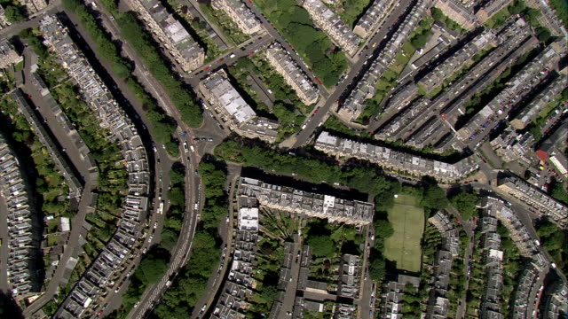 strips of parks are interspersed between residential neighborhoods. available in hd. - terraced house stock videos & royalty-free footage