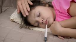 Stroking head of sleepy ill kid.