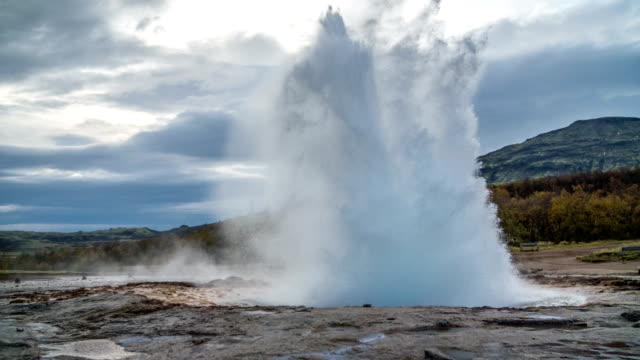 slow motion strokkur geyser iceland - geyser stock videos and b-roll footage