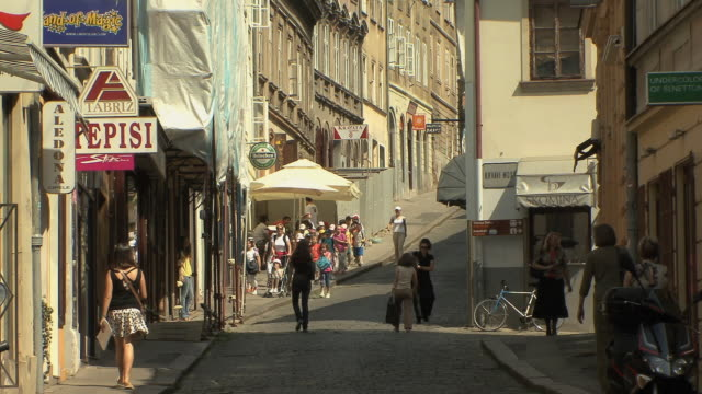 ws strollers and school children in old town / zagreb, croatia - three wheeled pushchair stock videos & royalty-free footage