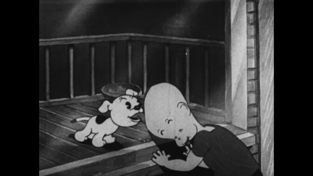 Strolling boy connects with puppy in Betty Boop's pet shop window