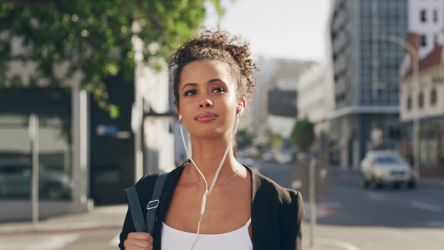 strolling through the city with her favourite sounds - headphones stock videos & royalty-free footage