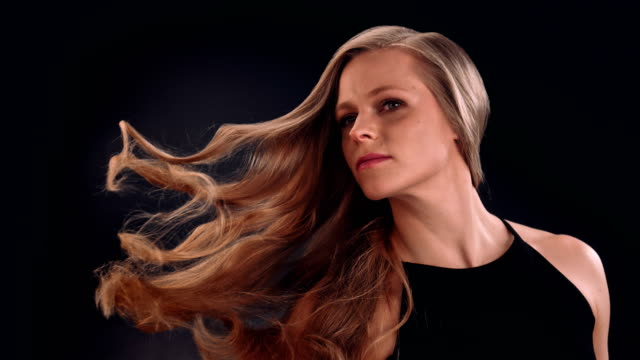 strong and beautiful blond woman tossing her long, wavy hair - hair treatment stock videos and b-roll footage